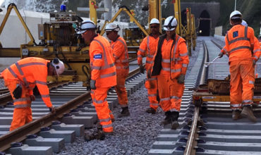 Rail construction, infrastructure development in Poland, construction workers