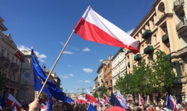 Polish and European Union flags at the parade on the occasion of Poland regaining independence.
