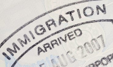 Immigration stamp. Personal immigration for a reason of working or studying are growing in Europe.